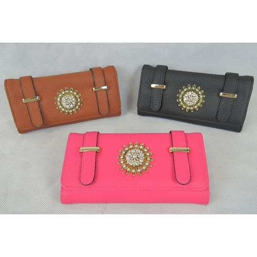 261 - Purses. Three purses; Black, Tan, and Pink each with sunflower embellishment and popper closure. Two...
