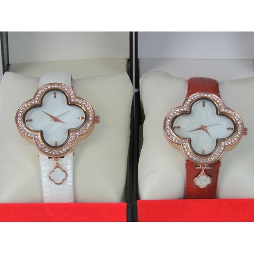 265 - Watches. Two bedazzled watches with flower shaped head. One with red crocodile effect strap and one ...