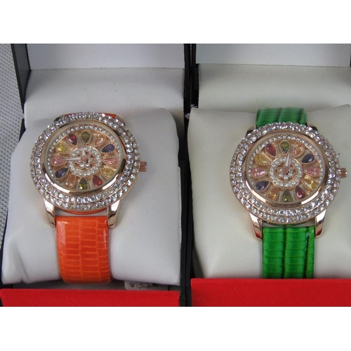 267 - Watches. Two bedazzled watches. One with orange crocodile effect strap and one with green crocodile ...