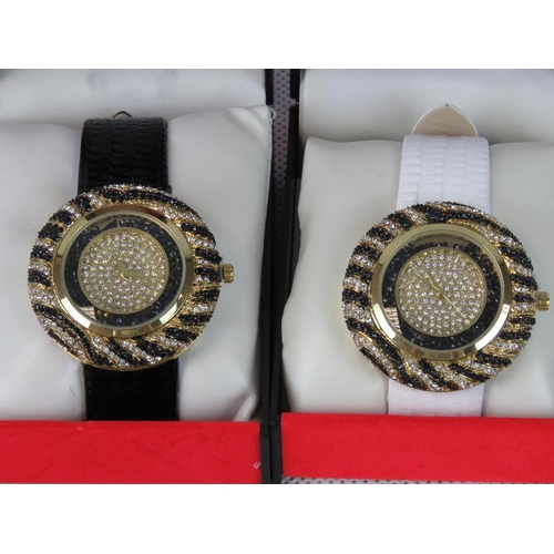 268 - Watches. Two bedazzled watches. One with black crocodile effect strap and one with white crocodile e...