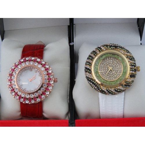 269 - Watches. Two bedazzled watches. One with red crocodile effect strap and one with white crocodile eff...