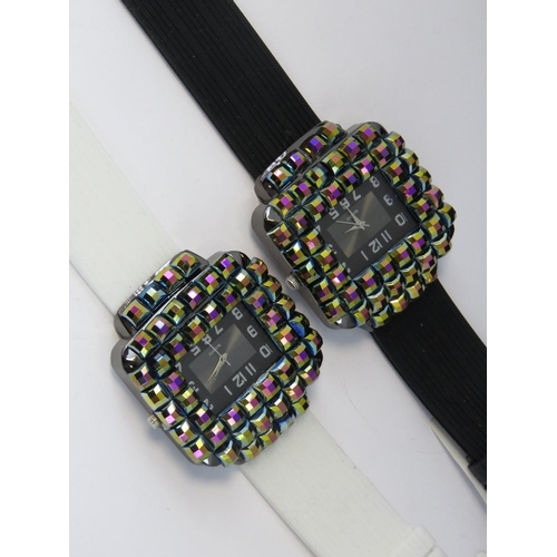 272 - Watches. Two bedazzled watches. One with black rubberised strap and one with white rubberised strap....