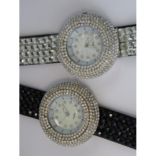 273 - Watches. Two bedazzled watches. One with black bedazzled strap and one with white bedazzled strap....
