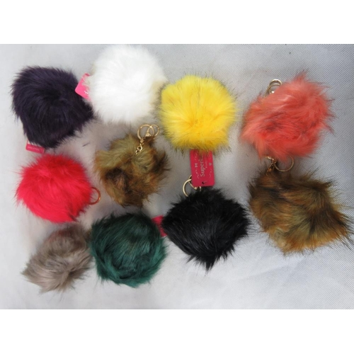 277 - Key chain. Ten fluffy ball keychains in mixed colours....