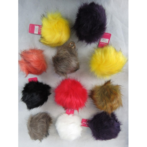 278 - Key chain. Eleven fluffy ball keychains in mixed colours....