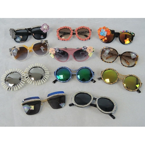 279 - Sunglasses. Eleven different pairs some bedazzles some with affix flowers and some plain....
