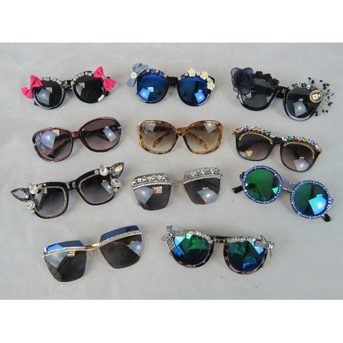 281 - Sunglasses. Eleven different pairs some bedazzles some with affix flowers and some plain....