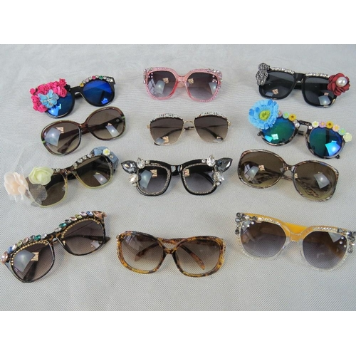 282 - Sunglasses. Twelve different pairs some bedazzles some with affix flowers and some plain....