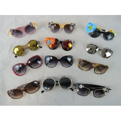 283 - Sunglasses. Twelve different pairs some bedazzles some with affix flowers and some plain....