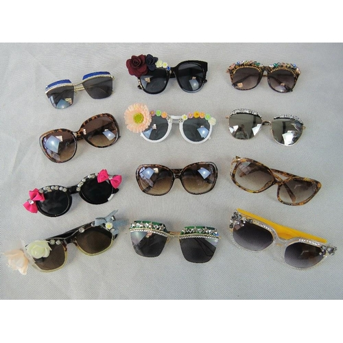 284 - Sunglasses. Twelve different pairs some bedazzles some with affix flowers and some plain....
