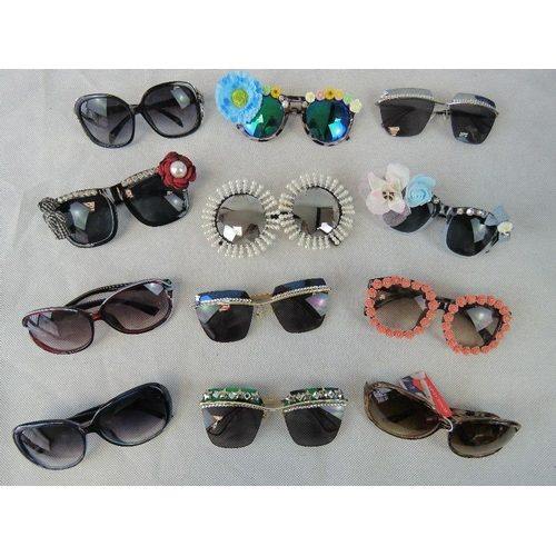 285 - Sunglasses. Twelve different pairs some bedazzles some with affix flowers and some plain....