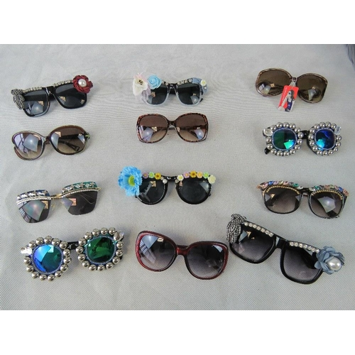 286 - Sunglasses. Twelve different pairs some bedazzles some with affix flowers and some plain....