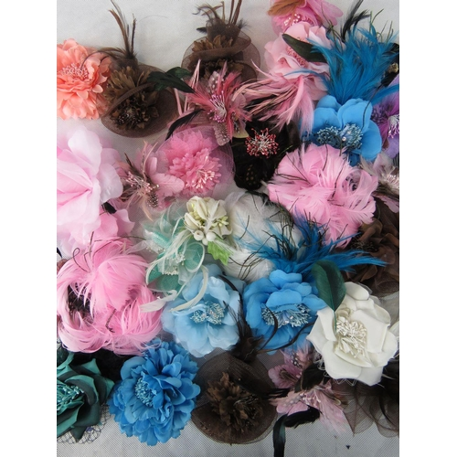 287 - Brooches/stick on flower and feather arrangements. Approx twenty-nine in mixed colours....