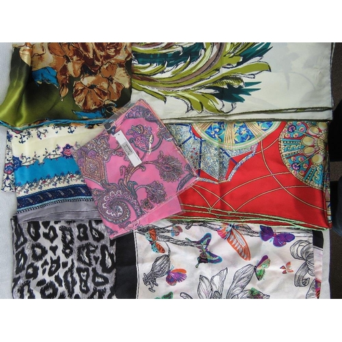 290 - Scarfs. Seven square silk scarfs. Variety of patterns....