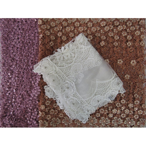 292 - Shawls. Three lace floral design shawls, dusky pink, white and brown....