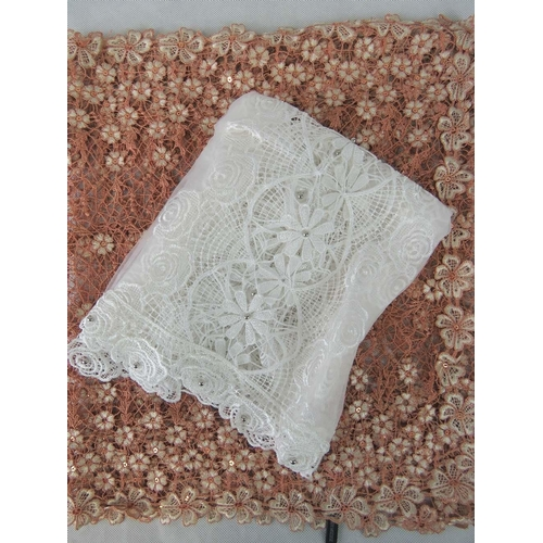 293 - Shawls. Two lace floral design shawls, white and brown....