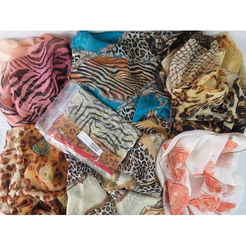 297 - Pashminas. Seven silk pashminas. Variety of colours and patterns....