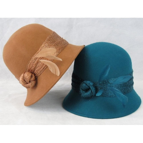 309 - Hats. Two lace knot and feather design, drawstring size adjustment, teal and tan....