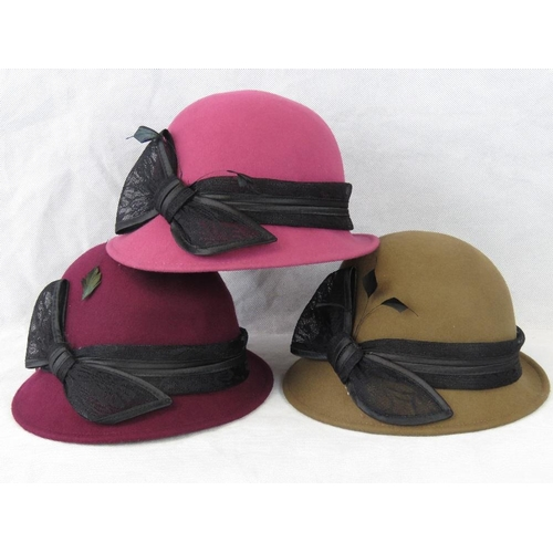 311 - Hats. Three lace bow and feather design, drawstring size adjustment, pink, purple and brown....