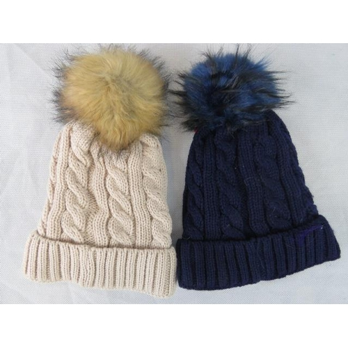 312 - Hats. Two fluffy bobble hats, brown and navy....