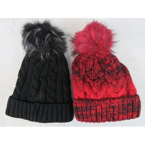313 - Hats. Two fluffy bobble hats, black and red....