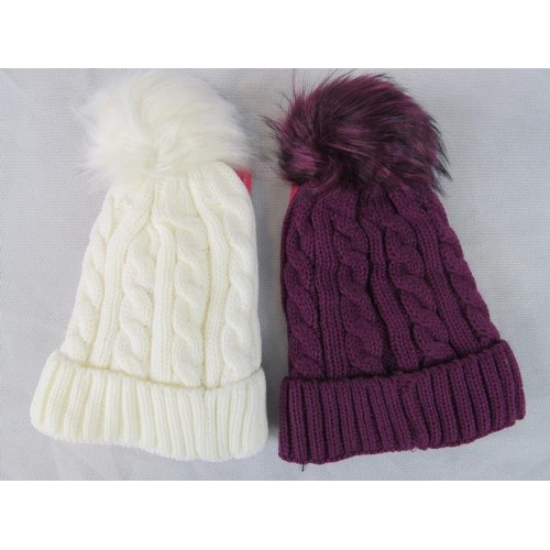 314 - Hats. Two fluffy bobble hats, purple and white....