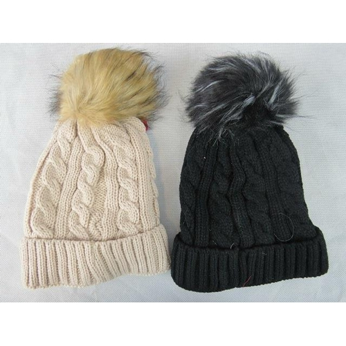 315 - Hats. Two fluffy bobble hats, brown and black....