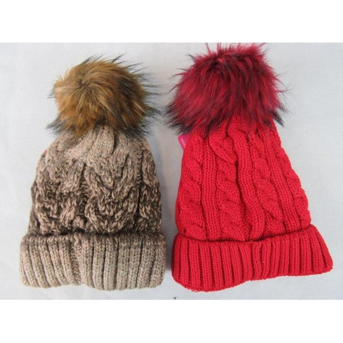 316 - Hats. Two fluffy bobble hats, brown and red....