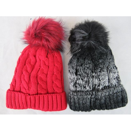 317 - Hats. Two fluffy bobble hats, black and red....