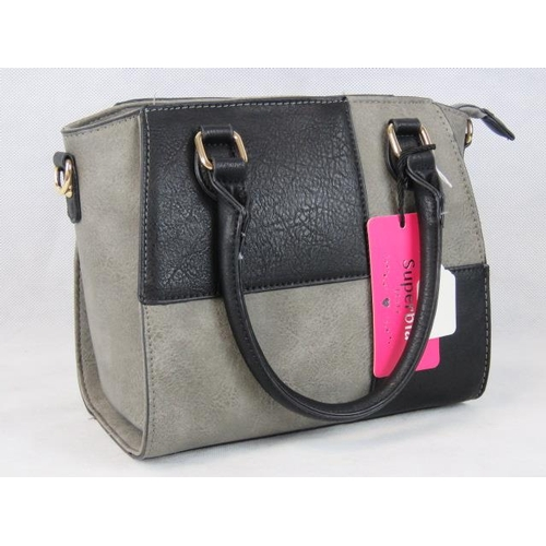 327 - Handbag. Black and grey chequered, two handles, two internal zip pockets and two internal open pocke...