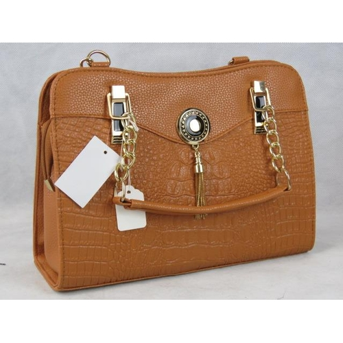 338 - Handbag. Tan python effect with tassel detail, two handles, zip closure, internal zip pocket, includ...