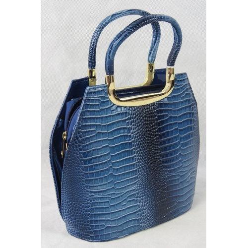 34 - Handbag. Blue python effect, two handles, zip closure, two internal zip pockets and two open pockets...