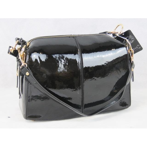 340 - Handbag. Black patent with buckle detail to sides, two detachable handles, two way zip closure, inte...