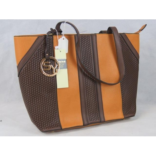 341 - Tote bag. Orange with brown pierced details, two handles, zip closure, internal zip pocket and two i...