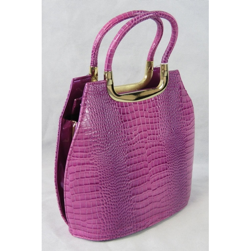 35 - Handbag. Purple python effect, two handles, zip closure, two internal zip pockets and two open pocke...