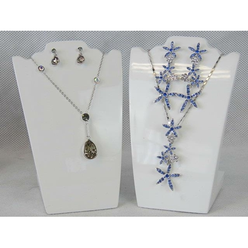 353 - Costume Jewellery. Two necklace and earring sets. One with rows of blue flowers the other with brown...