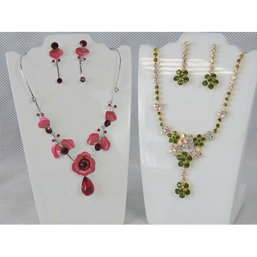 354 - Costume Jewellery. Two necklace and earring sets. One red flower design and the other with green and...