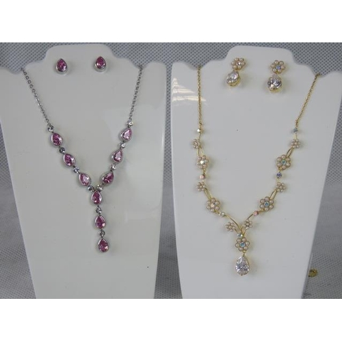 355 - Costume Jewellery. Two necklace and earring sets. One in faux seed pearl flower design, the other wi...
