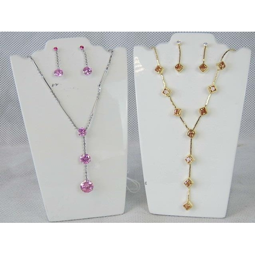 356 - Costume Jewellery. Two necklace and earring sets. One with square brown stones and one with pink and...