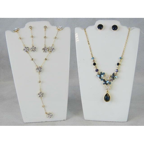 358 - Costume Jewellery. Two necklace and earring sets. One with white stone flower design, the other with...