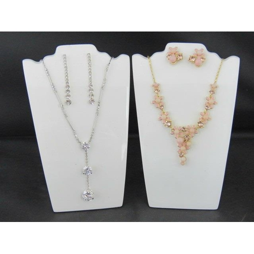 359 - Costume Jewellery. Two necklace and earring sets. One with pink flower and faux pearl design, the ot...