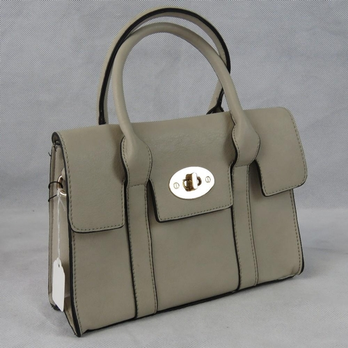 36 - Handbag. Taupe, two handles, clasp and zip closure, internal zip pocket and two internal open pocket...