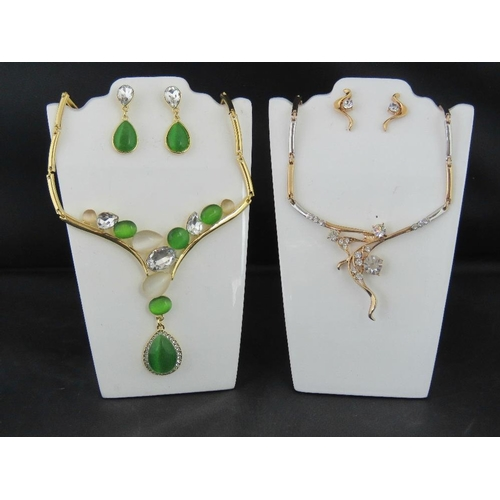 360 - Costume Jewellery. Two necklace and earring sets. One with green opalescent stones the other with wh...