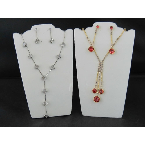 361 - Costume Jewellery. Two necklace and earring sets. One with square white stones, the other with red a...