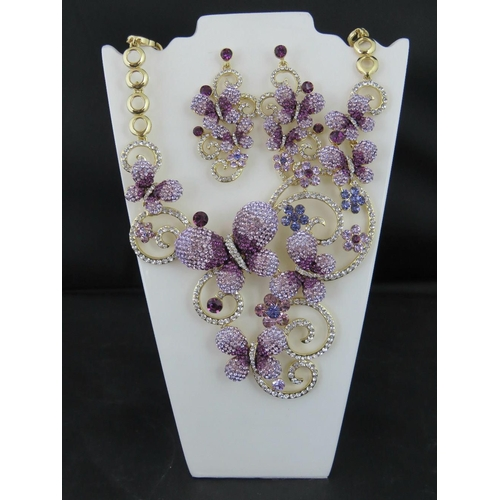 363 - Costume Jewellery. Necklace and earring set. Purple and white butterfly design (£88 tag on necklace)...