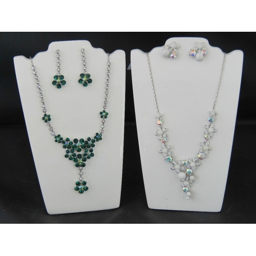 365 - Costume Jewellery. Two necklace and earring sets. One white flower and faux pearl design and one wit...