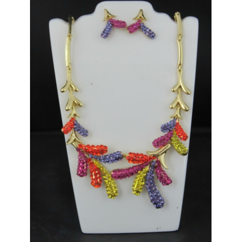368 - Costume Jewellery. Necklace and earring set. Multi colour leaf design (£51.99 on labels)...