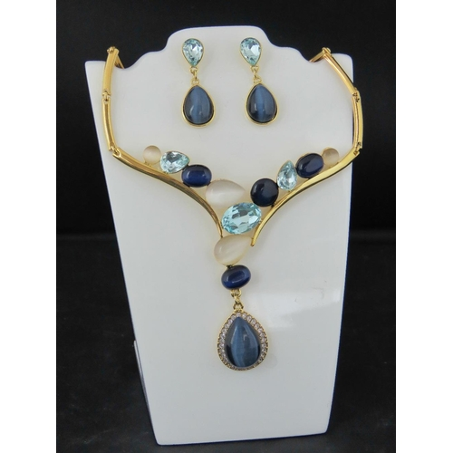 369 - Costume Jewellery. A necklace and earring set, blue and white opalescent stones (£31.99 on labels)...