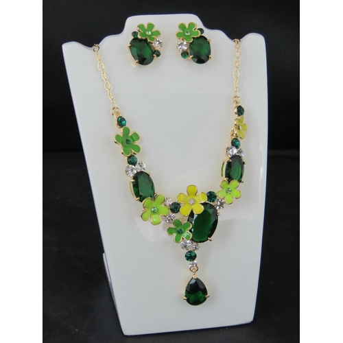 370 - Costume Jewellery. A necklace and earring set, Green flower design....