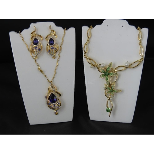 371 - Costume Jewellery. Necklace and earring set in purple and another necklace with green flower and fau...